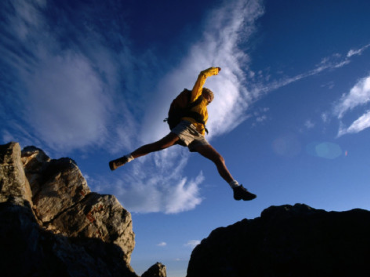 Picture showing person making a leap in high grounds