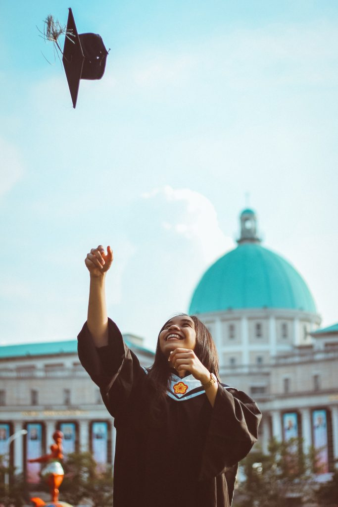 Graduate throwing hat